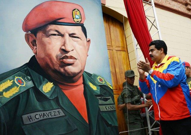 hugo-chavez-portrait-with-maduro