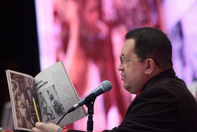 hugo chavez with book