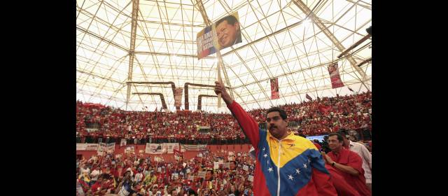 Venezuela's acting President Nicolas Maduro salutes supporters during a campaign rally in the state of Barinas
